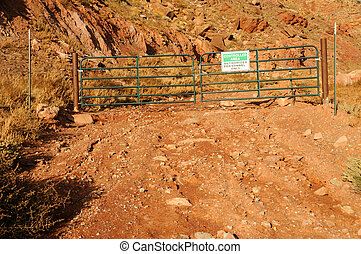 Gate with Restricted Area Notice at Uranium Mine Tailings...