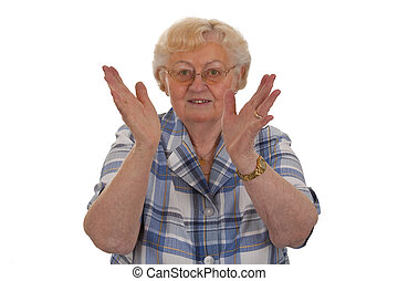 Applauding - Female senior clapping her hands - isolated on...