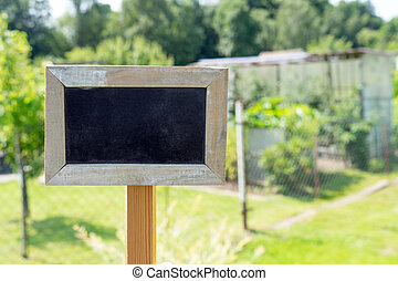 Allotment - blank sign in front of a garden plot