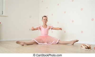 Ballerina Sitting On Floor - Young Ballerina Sitting On...