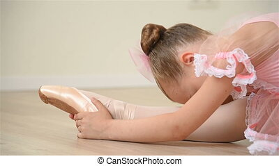 Ballerina Does Stretching - Young Ballerina In Pointe Shoes...