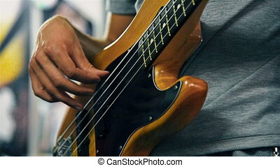 Guitarist Playing On Electrical Bass Guitar - Man Lead...