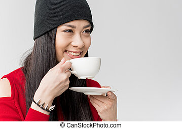 portrait of attractive asian woman holding tea cup isolated...