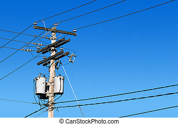 Power line post and blue sky - Energy and technology:...