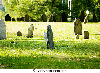 Cemetery with many tombstones on the bright day