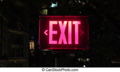 Safety exit sign darkness - Concept exit pink light outdoor...