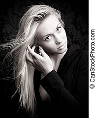 Glam model - Blonde model stroking hair, black and white