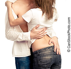 Embracing and undressing - Heterosexual couple, embracing...