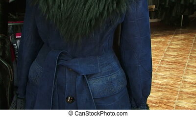 Stylish blue coat with fur collar. Motion zoom.