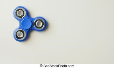 Fidget spinner isolated over white, top view. - Fidget...