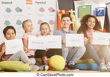 Children studying foreign language - Group of children...