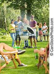 Grilling is fun - Group of friends having fun during...