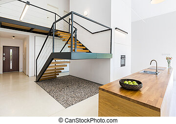 Modernistic interior with massive staircase of black metal...