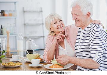 Senior man and woman at breakfast