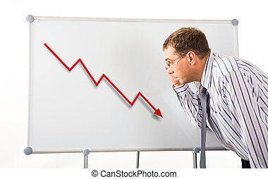 Recession - Image of serious man inclining to whiteboard and...