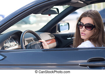 Lady in car - Portrait of elegant modern woman sitting in...