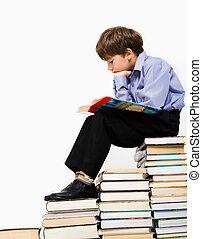 Reading boy - Photo of young boy reading a manual while...