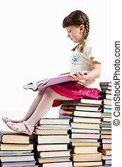 Smart reader - Profile of diligent pupil sitting on pile of...