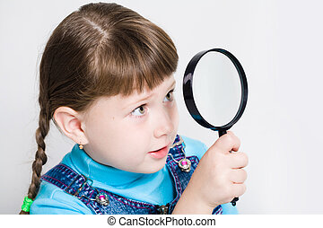 Look through a lens - Close-up of small girl holding looking...