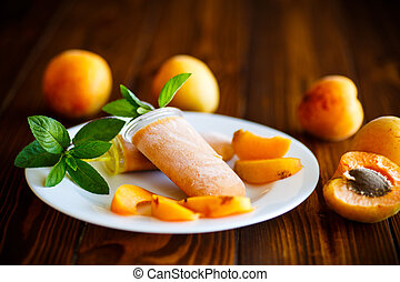 Sweet ice cream from apricots on a plate