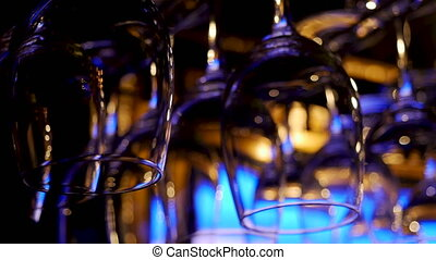 champagne glasses hanging on the rack