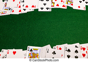 Cards On Baize - Playing-cards spread out on a green baize...