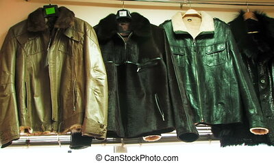 Stylish winter jackets - Elegant jackets hanging on a store...
