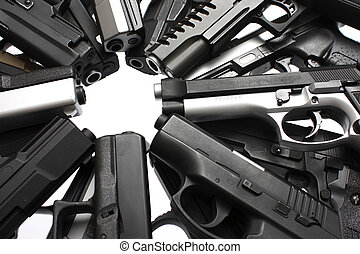 An assortment of pistols on a table.
