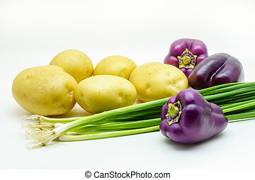 Assortment of fresh raw vegetables isolated on white background. Selection includes potato, green onion and peppers