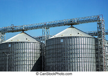 Industrial storage of raw materials in silos. Granary in the open sky.