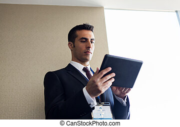 businessman with tablet pc computer at office