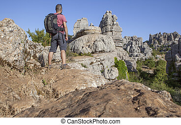 Man on rocky hill at Torcal de Antequera, Spain - Man...