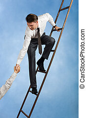 Help - Conceptual image of successful businessman standing...