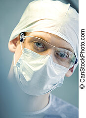 Face of specialist - Portrait of young specialist with mask...