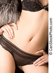 Feminine torso - Close-up of beautiful females body in black...