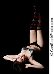 Attractive young woman wearing lingerie and argyle socks
