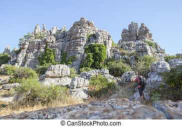 Man staring the impressive rock formations at Torcal de...