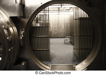 Vault door - The door of a bank vault.