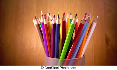Bright mug with colored pencils,