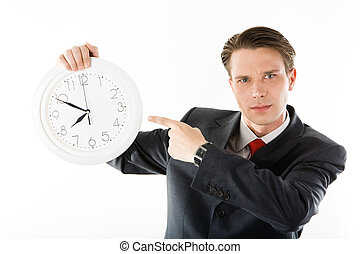 Be in time! - Portrait of serious businessman with clock...