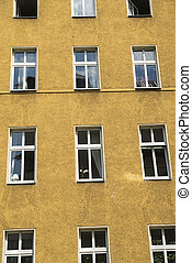 simple yellow house facade in Berlin Kreuzberg