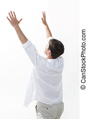 Praise - Image of excited man keeping his arms raised...