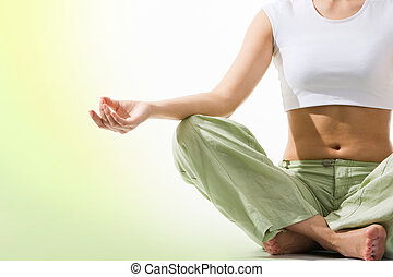 Tranquility - Close-up of female?s torso during meditation...