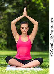 Female Young Fit Healthy Woman or Girl Practicing Yoga Outside