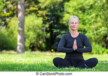 Mature Middle Aged Fit Healthy Woman Practicing Yoga Outside