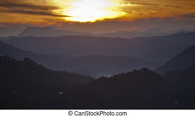Timelapse of the sunrise over the silhouettes of the mountains. Andreev.