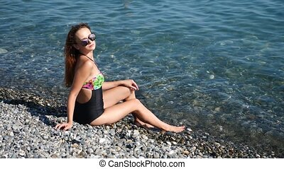 Sexy red-haired girl enjoys the sea. slow motion. 4K. - Sexy...