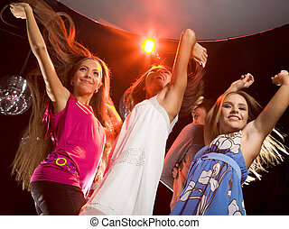 Glamorous dancers - Image of happy teenagers raising their...