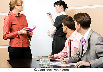 Presentation - Student and teacher looking at each other at...