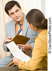 Planning - Smart businessman at background listening to his...